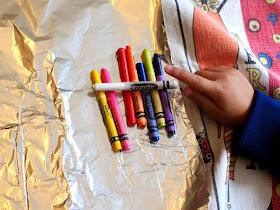 Peel crayons to make Melted Crayon Friendship Rocks
