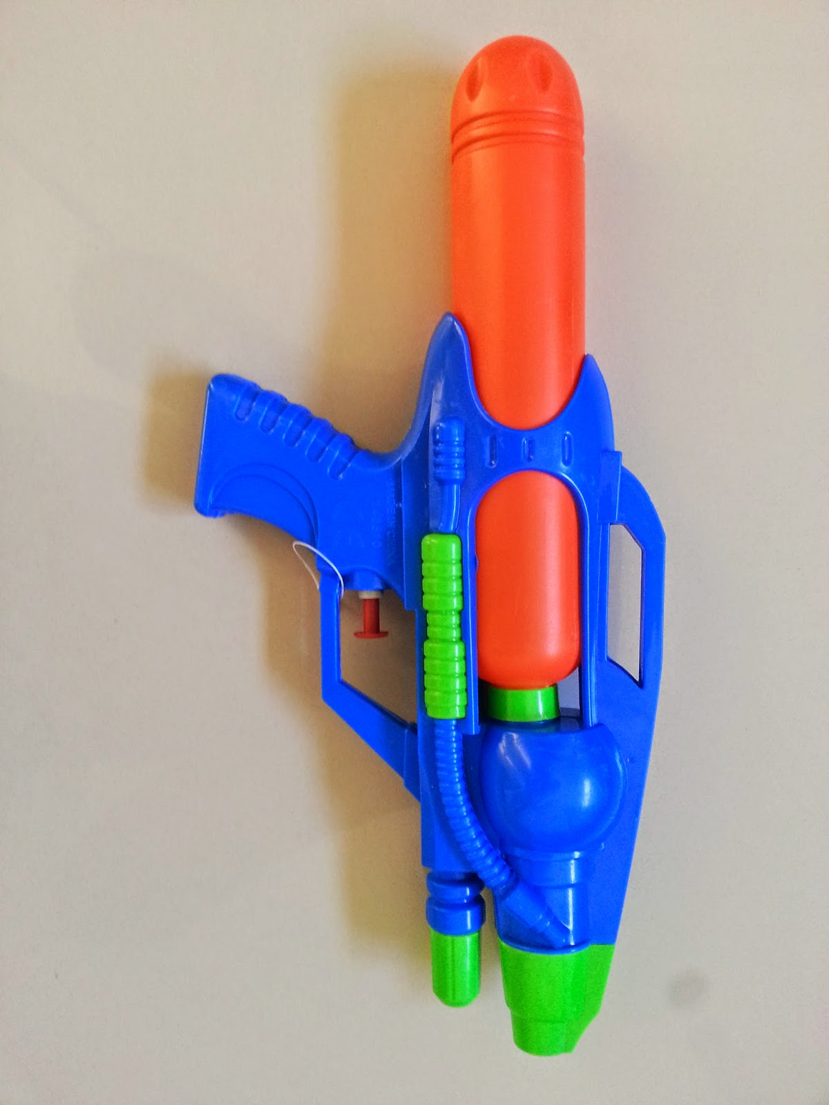 photo of blue, orange and green water pistol