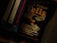 Mike McDermott retrieves money from a copy of Mike Caro's 'Poker Tells' in 'Rounders'