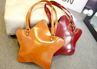 http://www.aliexpress.com/item/2015-New-women-pentagram-style-star-shoulder-bag-women-fashion-purses-irregular-shape-messenger-bag/32394493464.html