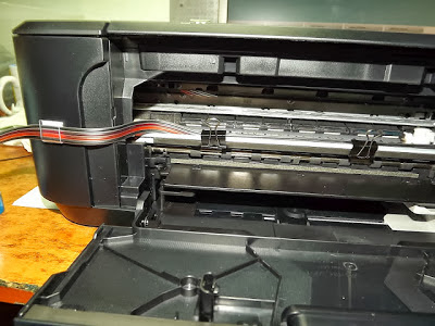 hoses coming out of the printer system