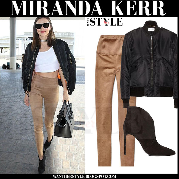 Miranda Kerr in black bomber saint laurent jacket and camel leggings and black ankle boots what she wore models off duty