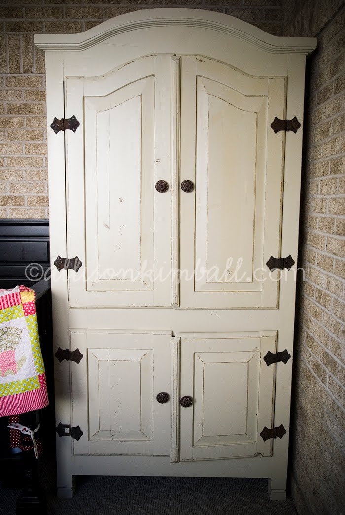 This Has Been Refinished In A Creamy White And Lightly Distressed. We Kept  The Original Outer Hinges To Maintain The Rustic Feel.