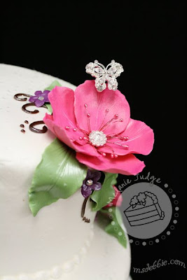 buttercream wedding cake gum paste flowers with rhinestones pink purple