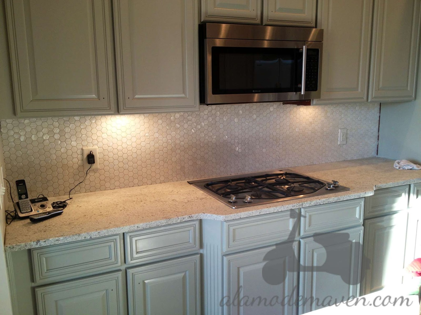 my tile designer seth from indigo granite and tile designs and i chose a mother of pearl hexagonal tile and i love it