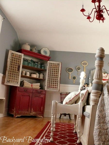red armoire in bedroom