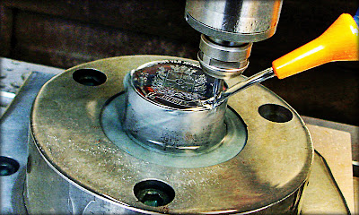 Coin stamp being made