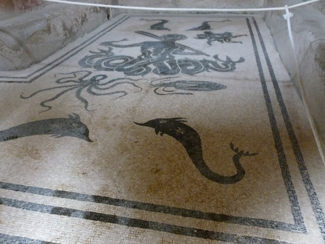 mosaic bathroom floor with black and white tiles depicting underwater scene