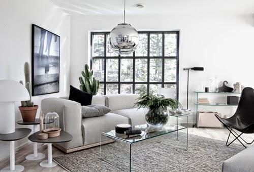 Salón blanco negro y gris con lámpara Tom Dixon