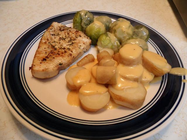 swordfish, Brussels sprouts, parsnips, cheddar bechamel sauce