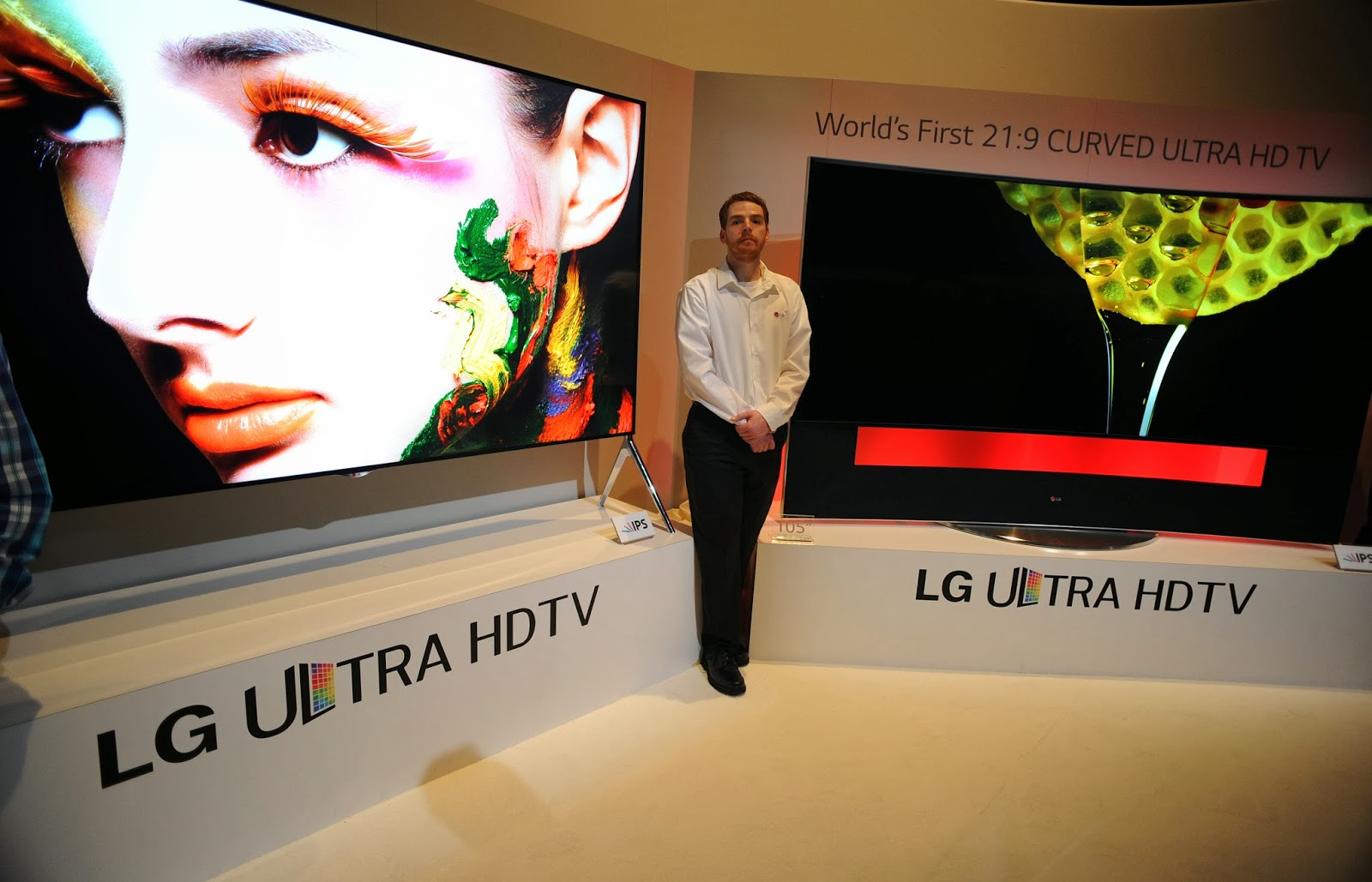 Business, Convention, Curved, Curved Display Screen, Economy, Electronics, Girl, International CES, LG, Mandalay Bay, Men, Nevada, Sales Man, Seller, Technology, TV, UHD, US,