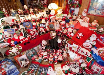 Canadian Jean-Guy Laquerre is surrounded by his Guinness record-breaking collection of Santa Claus memorabilia