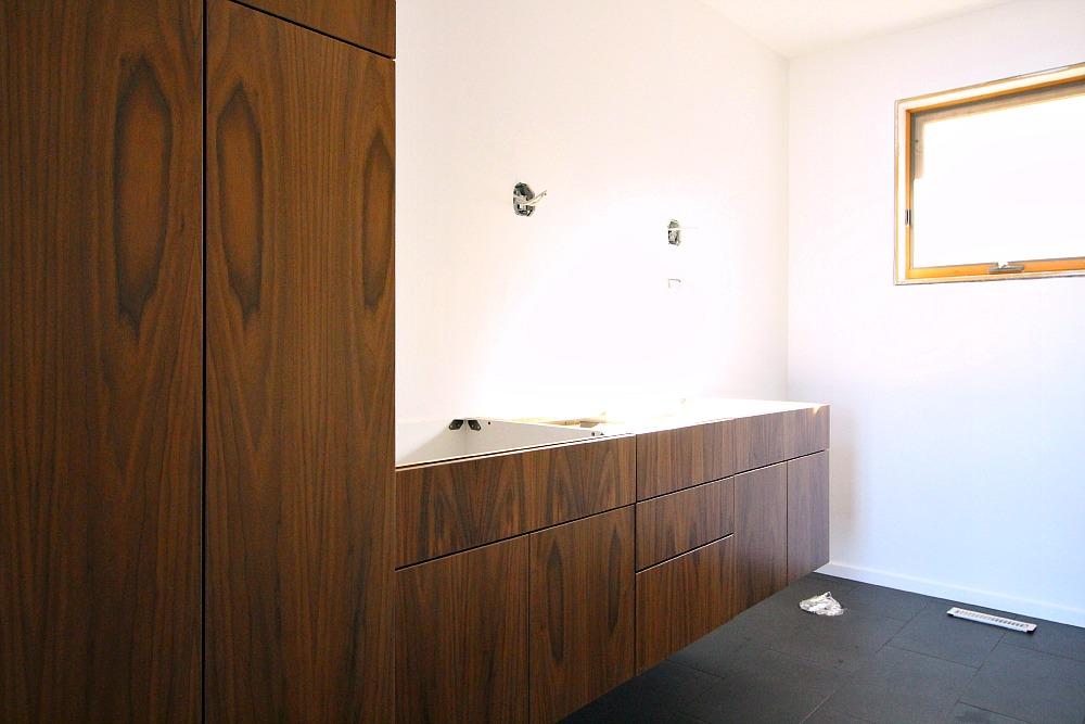 Floating Walnut Bathroom Cabinetry