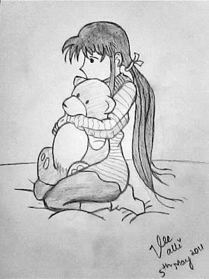 Lonely girl hugging her teddy