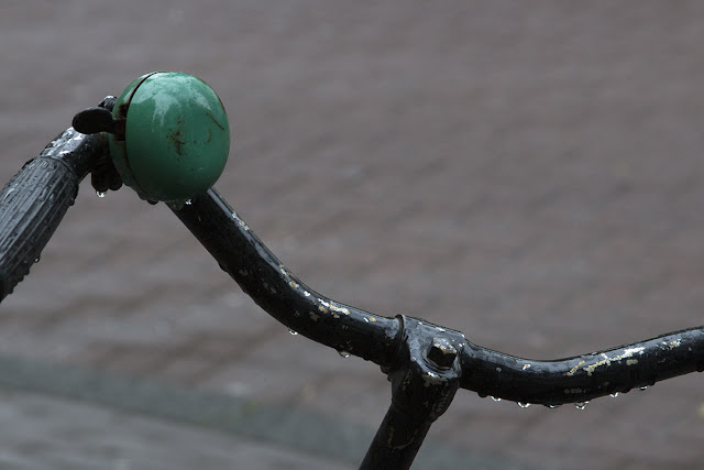 bicycle with green bell and raindrops
