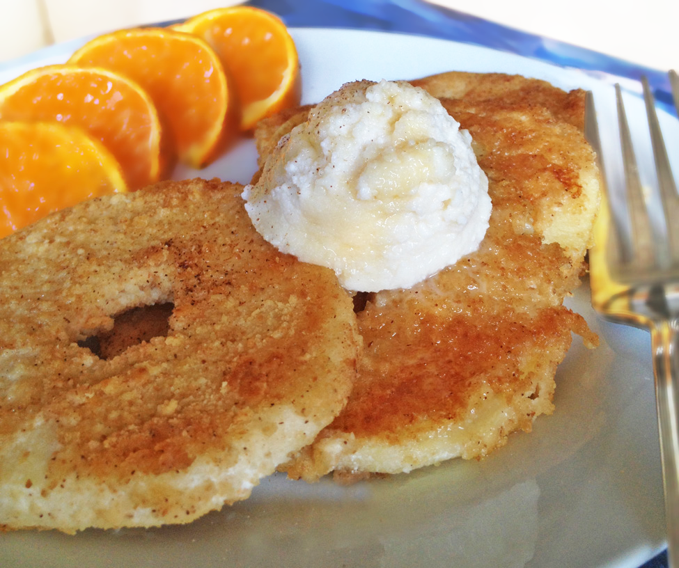 Image of Cinnamon Apple Rings topped with Sweetened Ricotta and served with a sliced tangerine.