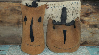 A Pair of Hand Made Early Woolen Pumpkin Faces ready to hang!