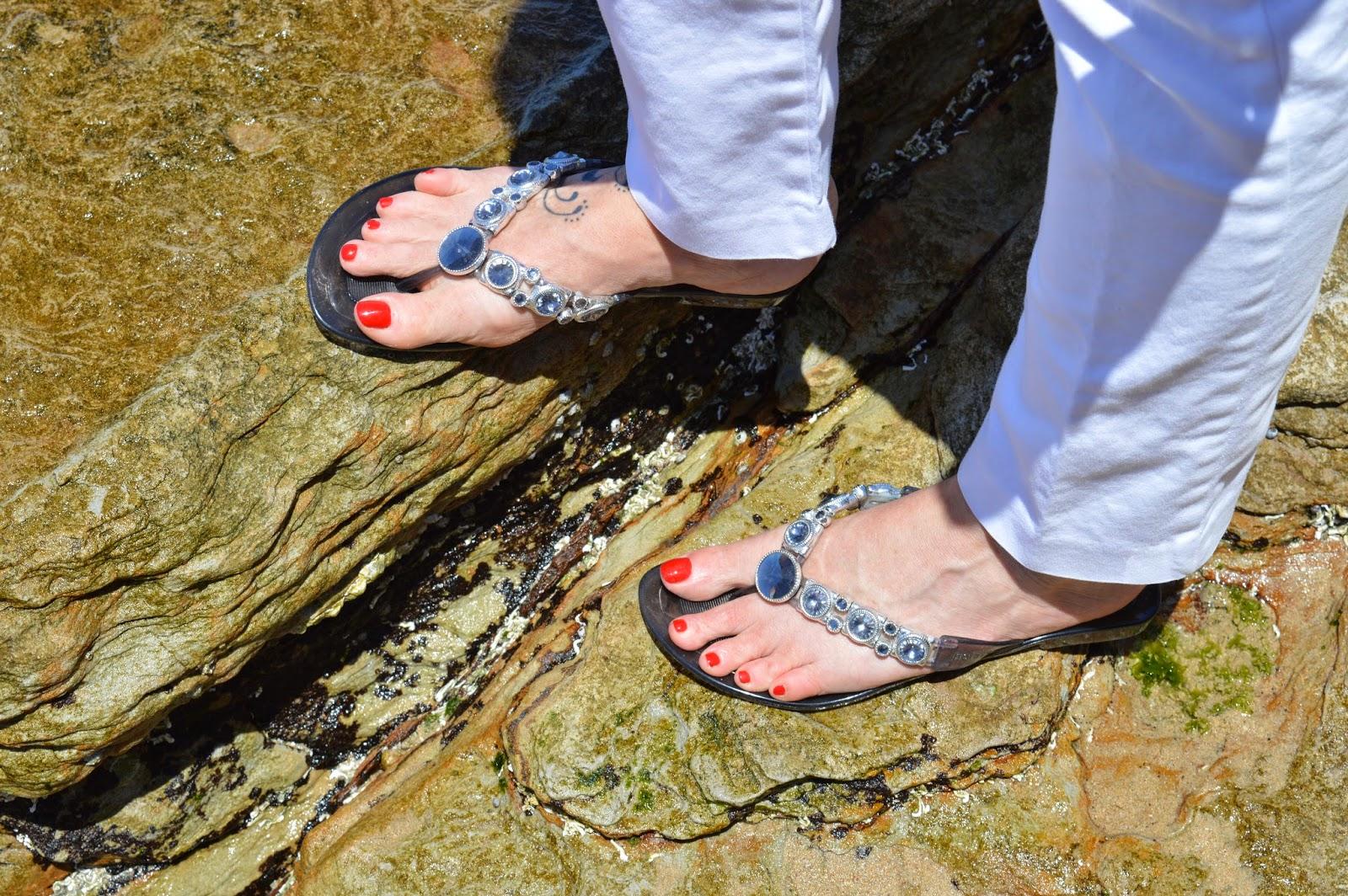 SFH wearing Holster thongs at Cronulla beach.
