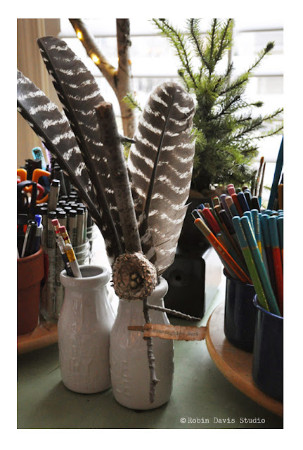 Turkey feathers with a real hummingbird next display | Robin Davis STudio