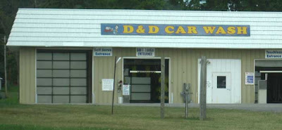 Metal building with sign reading D&D Car Wash