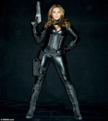 Action heroine: Kelly Brook appears as a gun-toting superhero in new ...