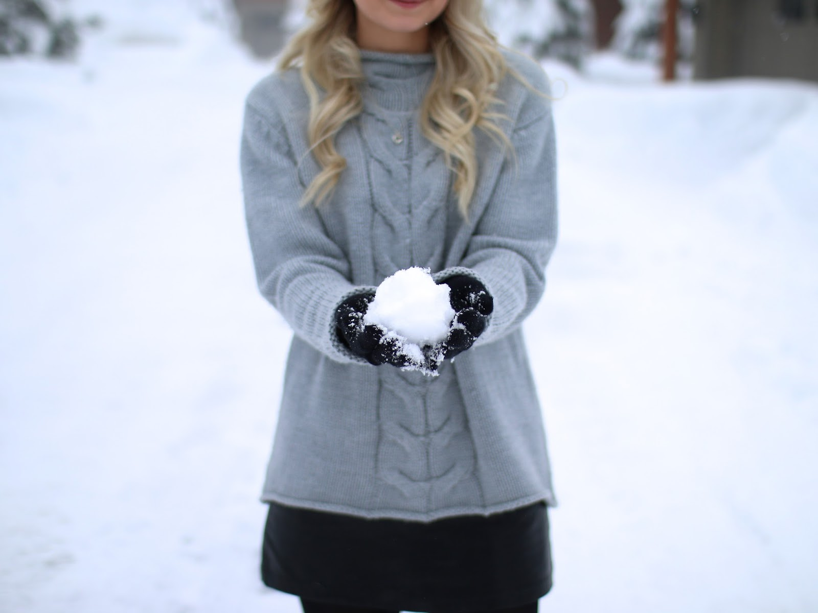 light a fluffy snow in whistler bc, snowball photography, snowball in hands