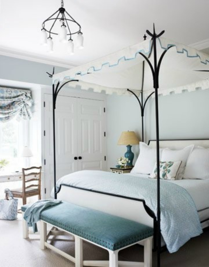Coastal bedroom with iron canopy four poster bed