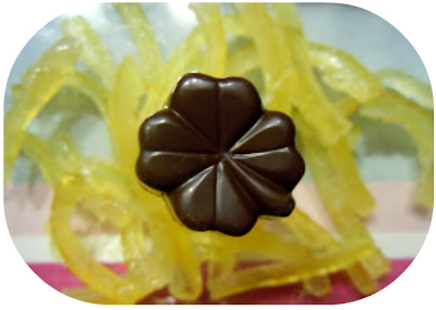 Praline chocolat noir, praliné noisette et citrons confits