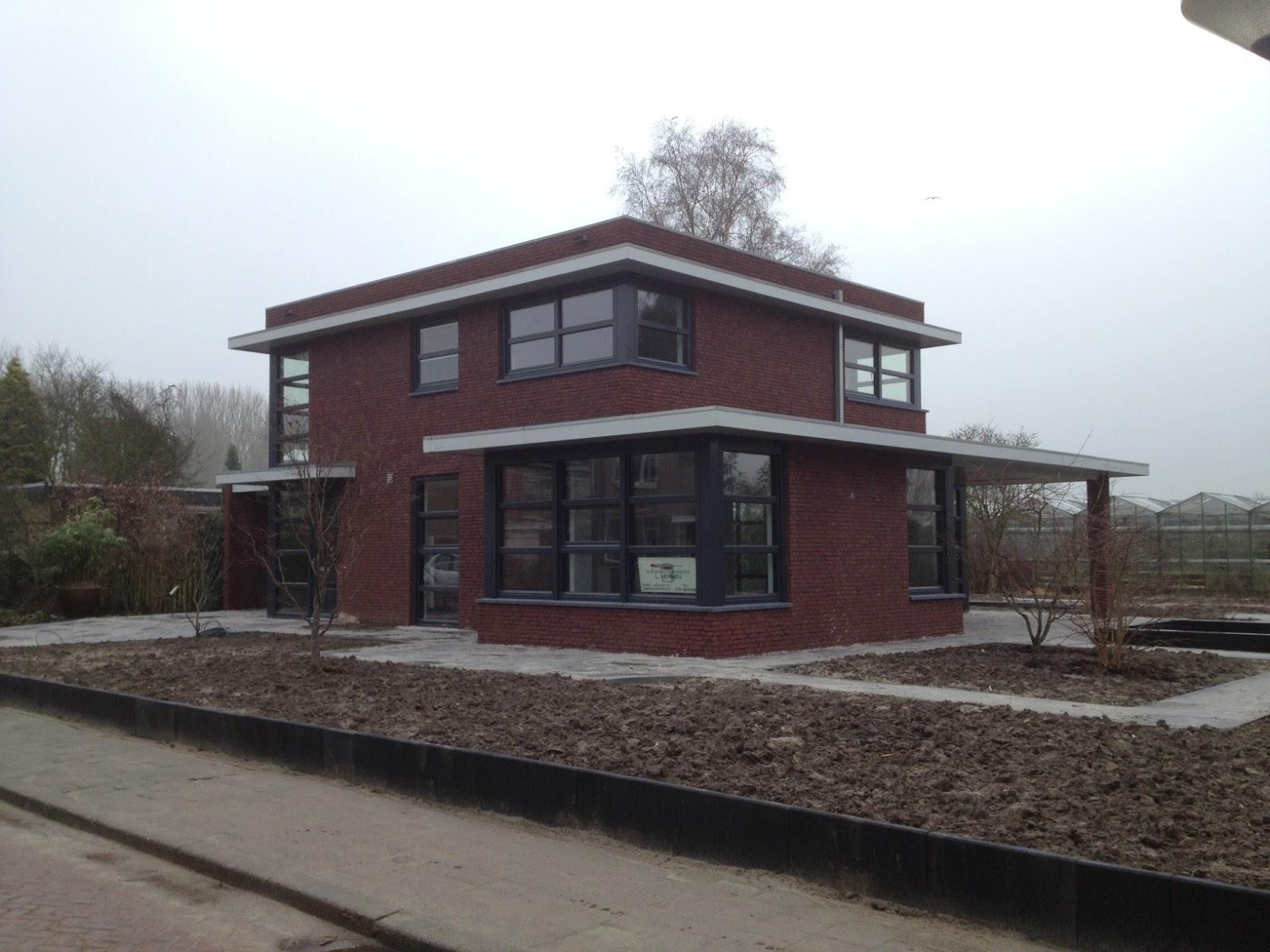 Van der padt partners architecten moderne woning te dordrecht opgeleverd for Moderne huis foto