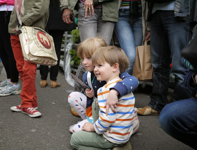 Henry and Coco watching buskers at Columbia Road flower market in April by Alexis www.somethingimade.co.uk