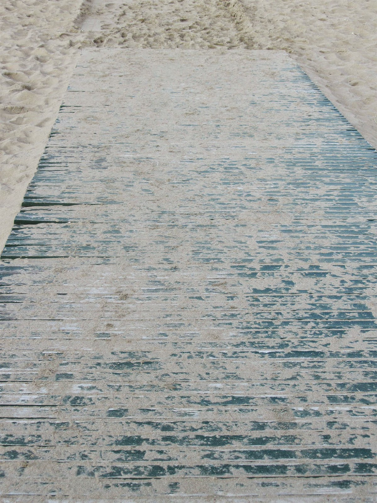 wooden floor leading to the beach