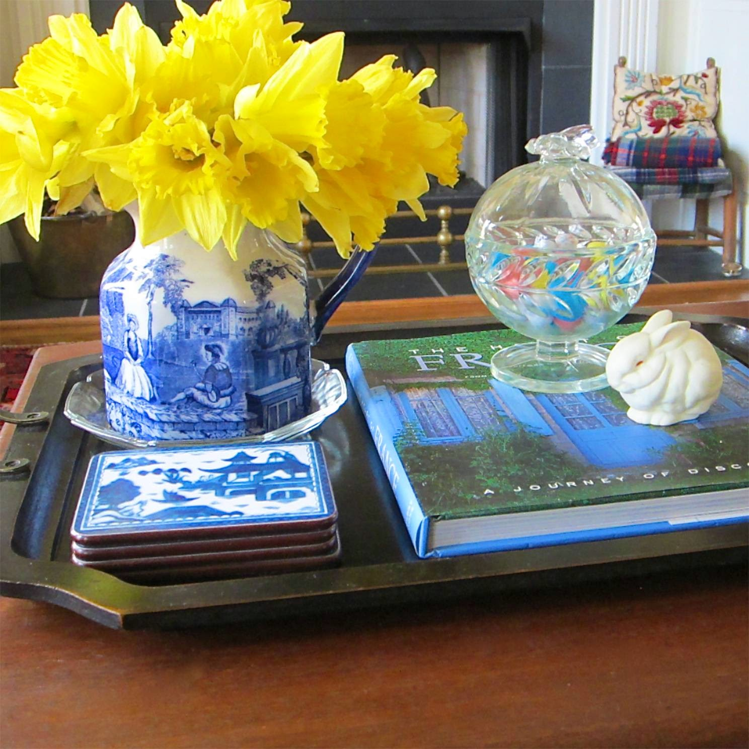 daffodils in blue and white pitcher