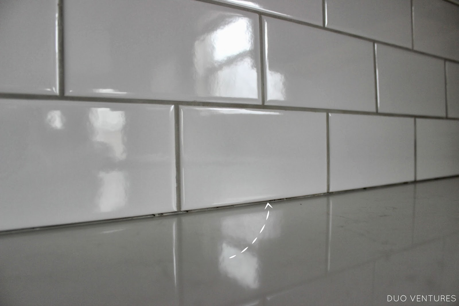 ventures kitchen update grouting caulking subway tile backsplash