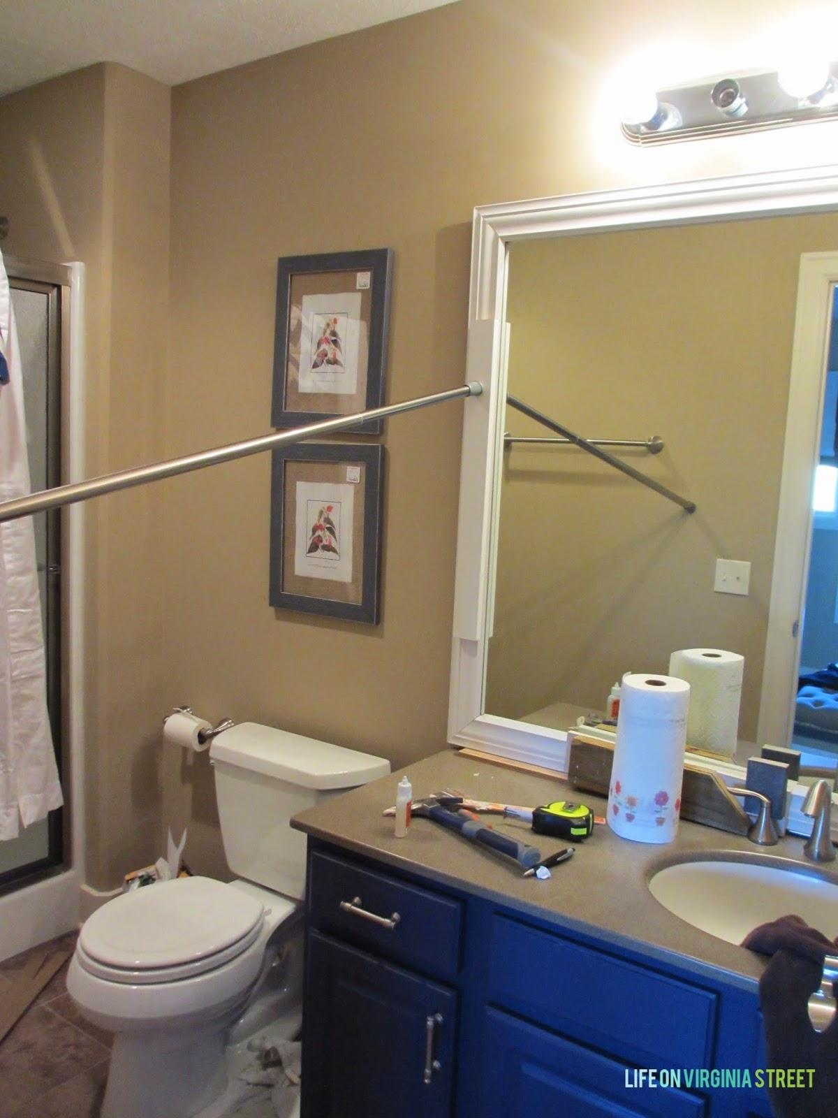 Framing builder grade bathroom mirror