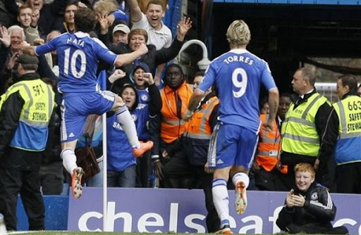 Chelsea player Juan Mata celebrates after scoring the winning goal against Wigan