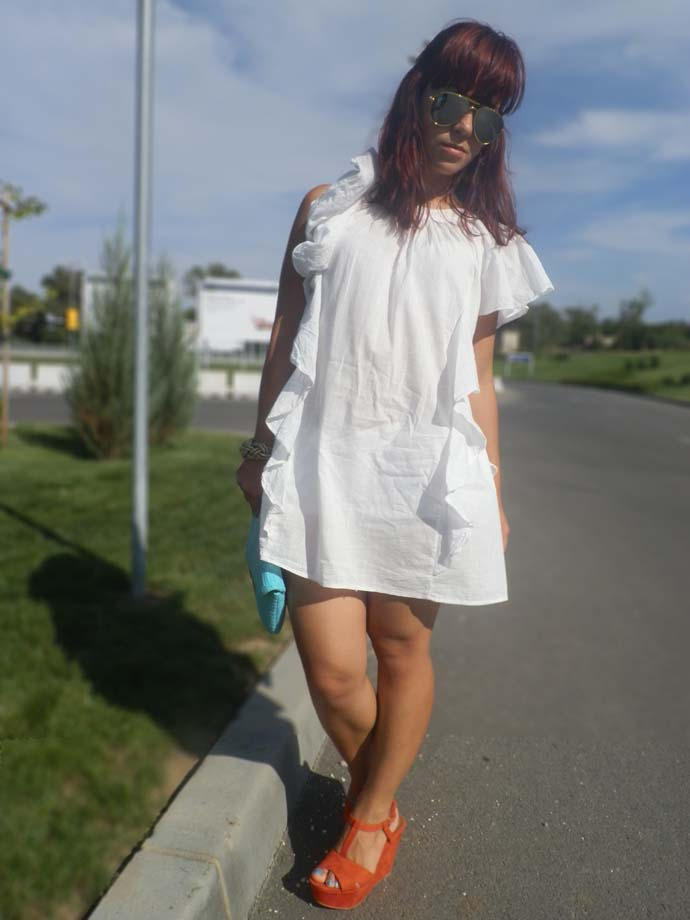 Outfit I am wearing: Thrifted white summer dress with ruffles, white shorts from H&M, Turquoise clutch and Golden  bracelet from Primark, Vintage Ray Ban Sunglasses, Orange suede wedges from Zara