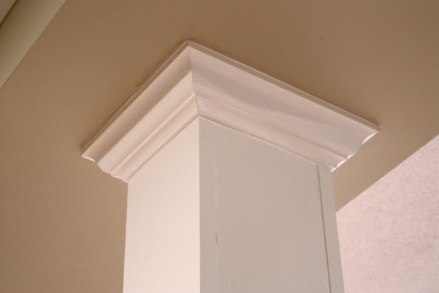 Dress up basement columns with crown molding