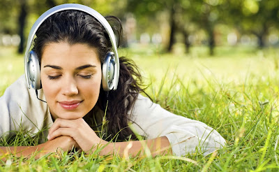 Girl with headphones in Park wallpaper