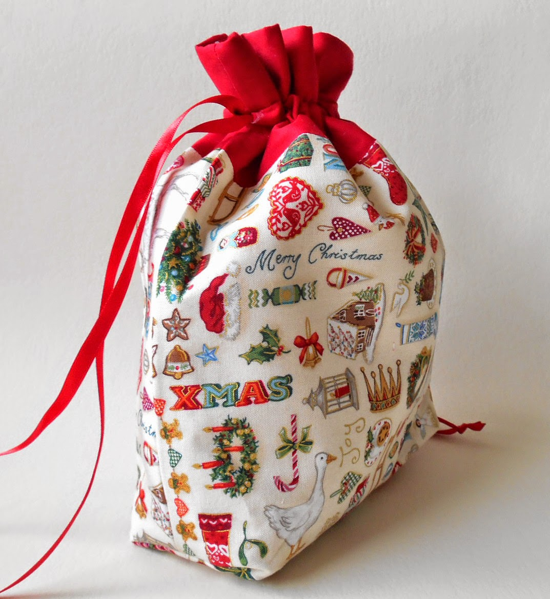 cream gold and red christmas gift drawstring bag
