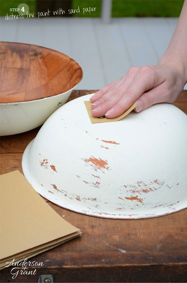 After painting the DIY bowls with chalk paint, use sand paper to distress the finish   www.andersonandgrant.com