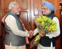 Gujarat Chief Minister Narendra Modi greets Prime Minister Manmohan Singh in New Delhi