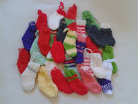Lots and lots of mini Christmas stockings in various colours