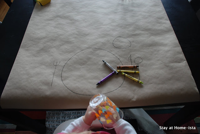 Using craft paper to create a tablecloth for a dinner with kids