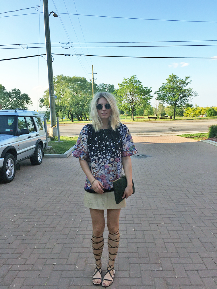 Vintage floral top, vintage leather mini skirt, high-top gladiator sandals, Ray-Ban Lennon sunglasses, suede pouch