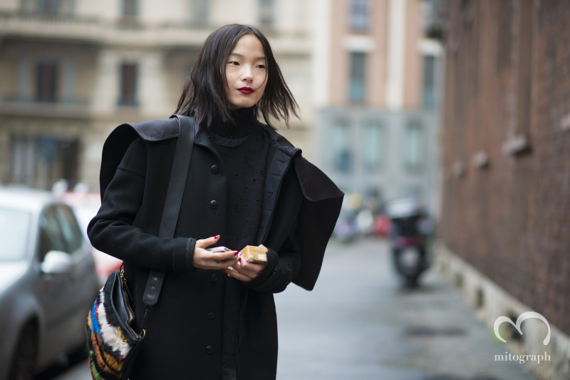 Model Xiao Wen Ju is waiting her driver after MaxMara Milan Fashion Week 2014 Fall Winter Season MFW