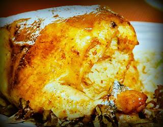 Pollo relleno de arroz