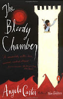The Bloody Chamber bookcover. Black background, white castle with girl hanging out and calling for help, surrounded by angry red waves