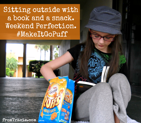 Enjoying the weekend with a book and Goldfish snack
