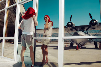 woman at airport, woman looking into glass, top fashion photographers