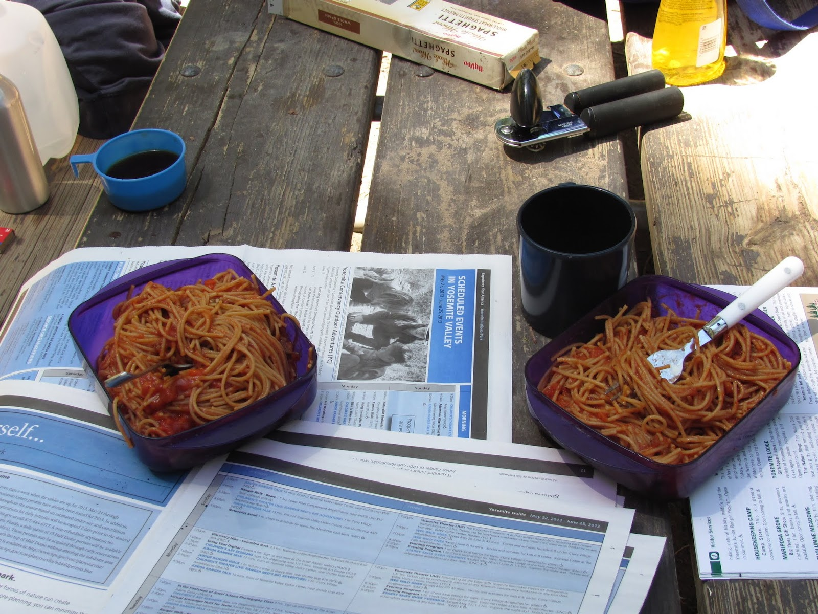 Bowls of spaghetti and park pamphlets cover the picnic table at Yosemite National Park, California